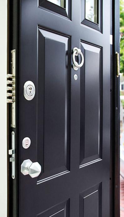 black residential steel security door with glass